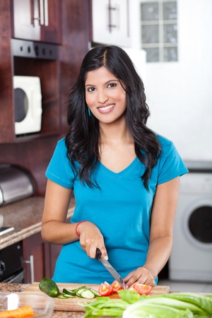young beautiful casual woman cooking in kitchen  photo
