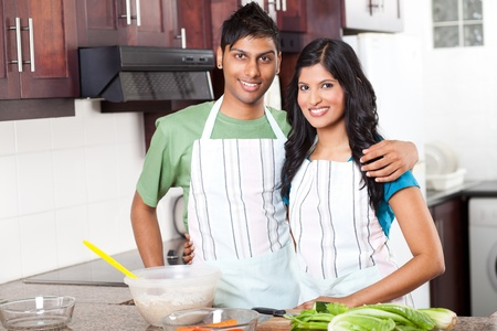 modern young  indian couple in kitchen  photo