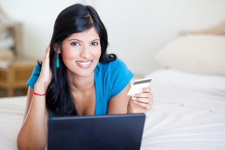 attractive modern young woman shopping online Stock Photo - 12728099