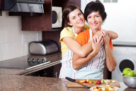 middle aged mother and teen daughter in kitchen (kitchen,\ mom)