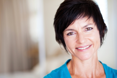 mature brunette: closeup portrait of elegant middle aged woman portrait Stock Photo