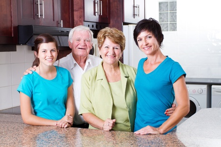 3 generation family portrait in kitchen Stock Photo - 12728494