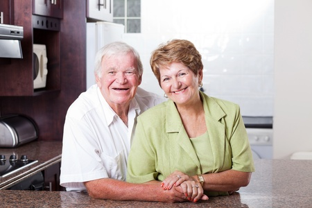 happy loving senior couple portrait at home photo