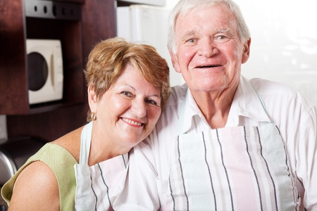 happy senior couple portrait in home kitchen photo