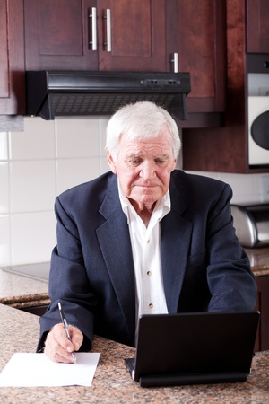 senior man doing internet banking at home and looks worried Stock Photo - 12728530