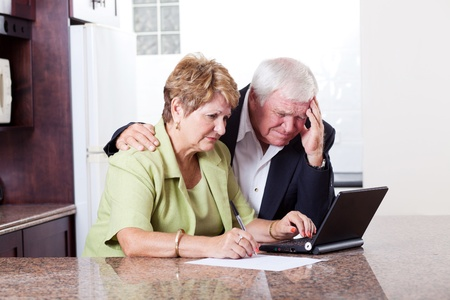 sad old woman: senior couple worrying about their money situation Stock Photo