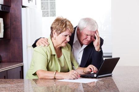 unhappy family: senior couple worrying about their money situation Stock Photo