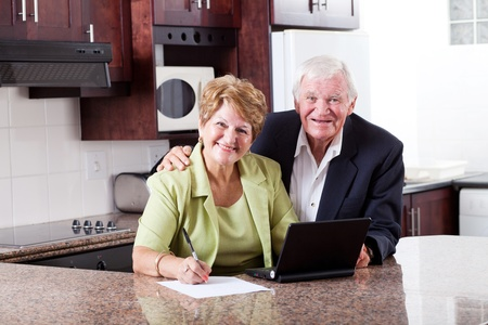 happy senior couple checking retirement investment photo