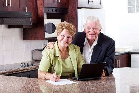 retirement fund: happy senior couple checking retirement investment Stock Photo