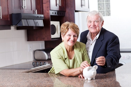 retirement couple: happy senior couple saving for retirement