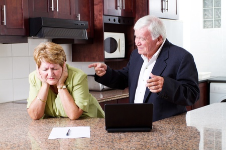 family fight: senior husband pointing fingers at his wife Stock Photo
