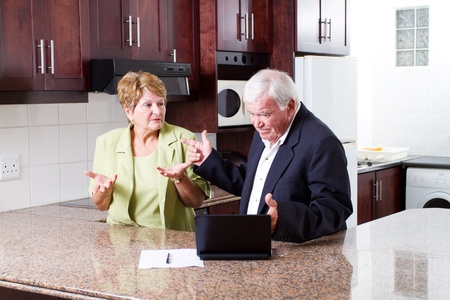 elderly couple having argument over expense photo