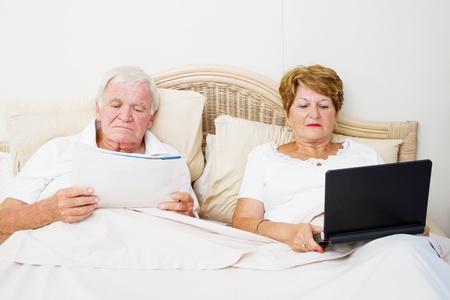senior couple reading in bed before sleep Stock Photo - 12728207