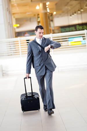 business briefcase: businessman rushing in airport to catch a flight Stock Photo