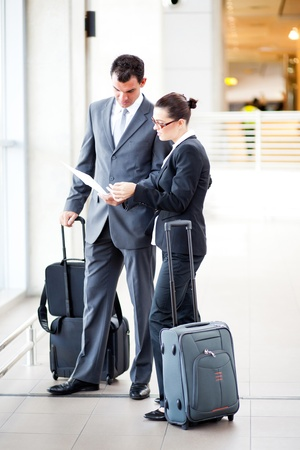 businessman and businesswoman at airport photo