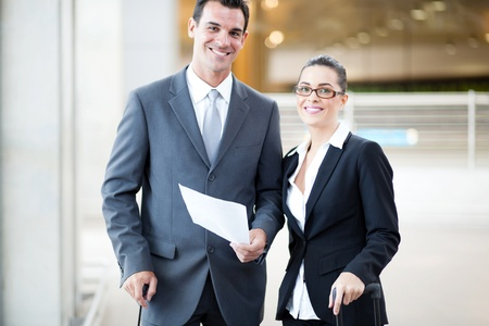 happy young businessman and businesswoman at airport photo