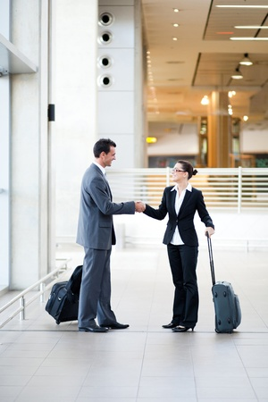 business travellers meeting at airport photo
