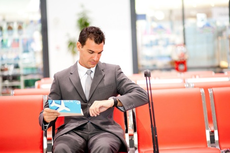 jetsetter: young businessman waiting his fight at airport
