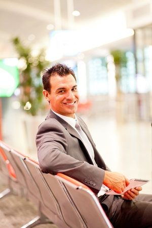 jetsetter: handsome young businessman using tablet computer at airport