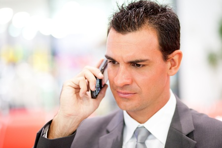 jetsetter: serious businessman on cell phone