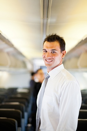 young businessman on airplane Stock Photo
