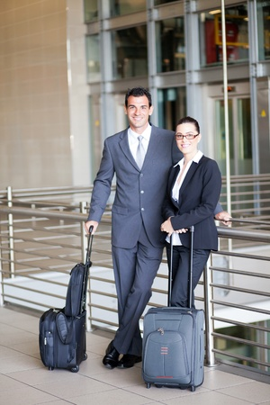 two young business travellers at airport photo