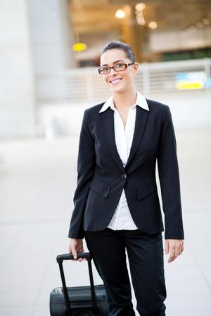 jetsetter: female jetsetter walking in airport