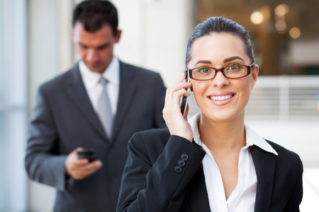 cell phone: beautiful young businesswoman talking on cell phone