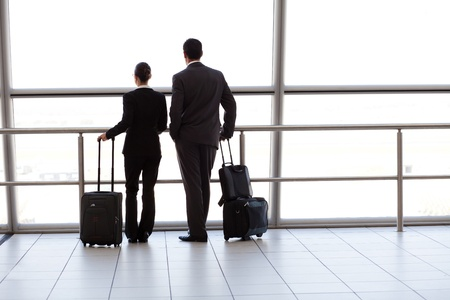 silhouette of two businesspeople at airport photo
