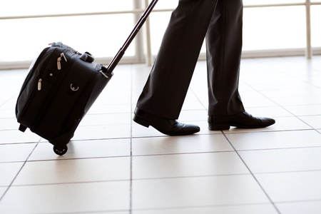 man legs: silhouette of businessman walking in airport Stock Photo