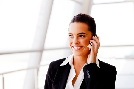 pretty young businesswoman talking on cell phone photo