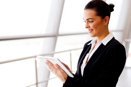 young businesswoman using tablet computer photo