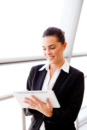 young attractive businesswoman using tablet computer photo