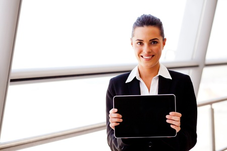 attractive young businesswoman holding a tablet computer photo