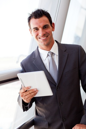 handsome young businessman using tablet computer photo