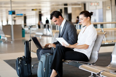 business travellers waiting for their flight at airport photo