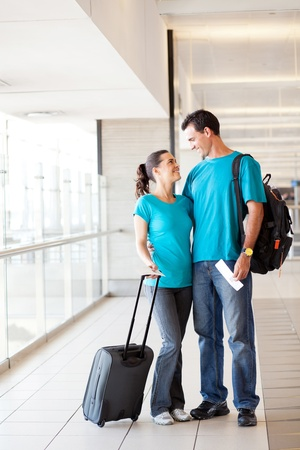happy young couple at airport photo