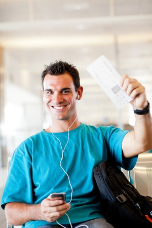 happy young man at airport with boarding pass Stock Photo - 12897898