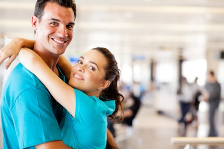happy young couple reunion at airport Stock Photo - 12897902