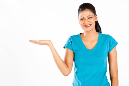 average woman: happy indian woman presenting on white background Stock Photo