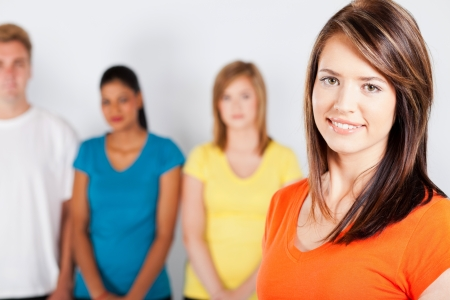 beautiful young woman standing in front of group of people photo