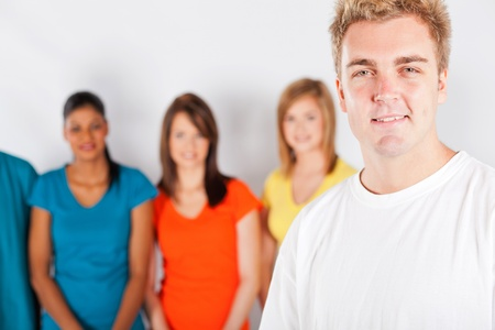 young man in front of group of people Stock Photo - 13058808