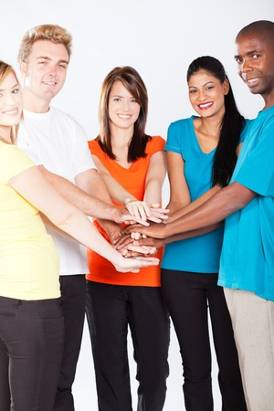 group of young multiracial people hands together photo