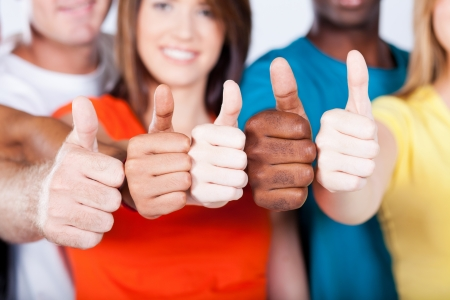 diverse hands: group of multiracial friends thumbs up Stock Photo