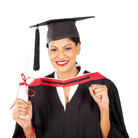 cap and gown: female indian graduate isolated on white background  Stock Photo