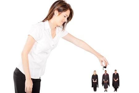 funny graduation - young woman putting cap on graduates photo