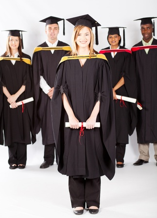 female university student at graduation with classmates photo