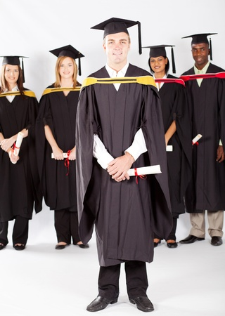 male college student at graduation with classmates photo