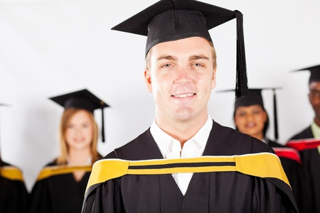 happy male college graduate with classmates at graduation photo