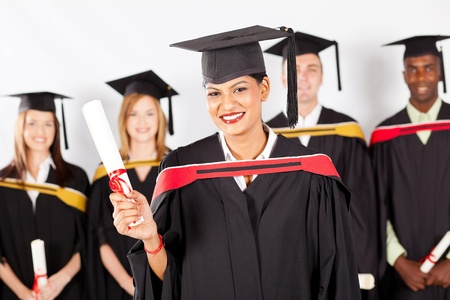 happy female indian graduate with classmates at graduation photo